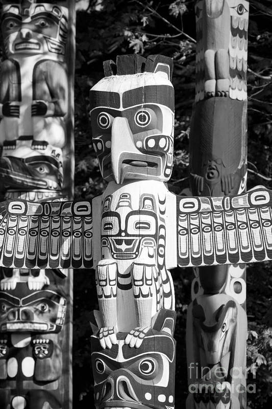 Totem Poster featuring the photograph Totems by Chris Dutton