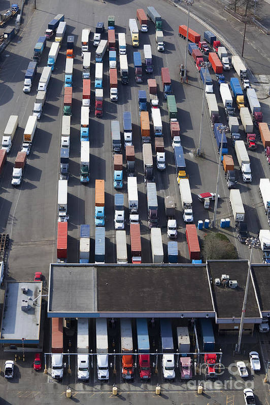 18 Wheeler Poster featuring the photograph Aerial View Of Semi Trucks At Port by Don Mason