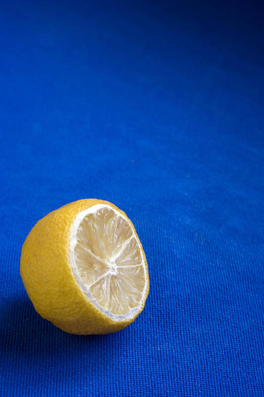 Blue Poster featuring the photograph Just A Lemon by Steve Outram