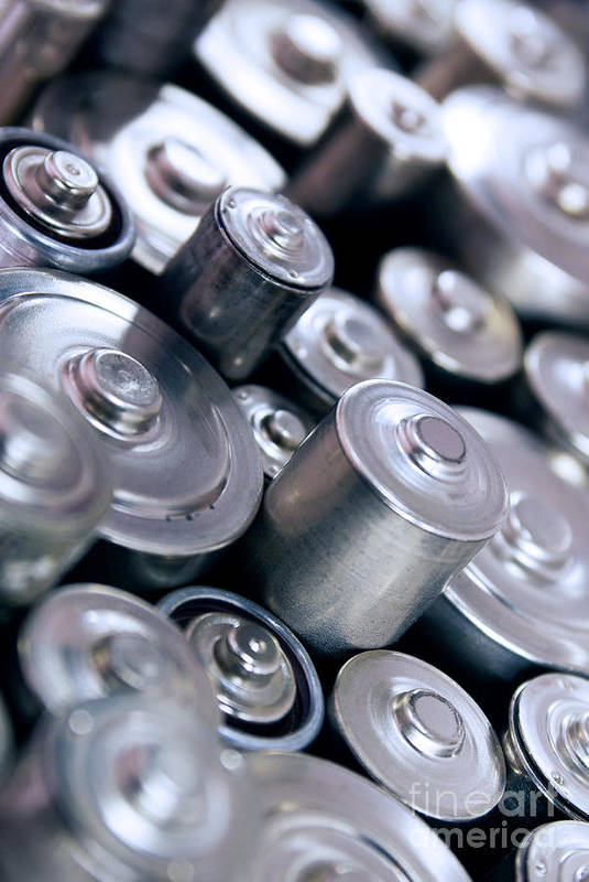 Abstract Poster featuring the photograph Stack Of Batteries by Carlos Caetano