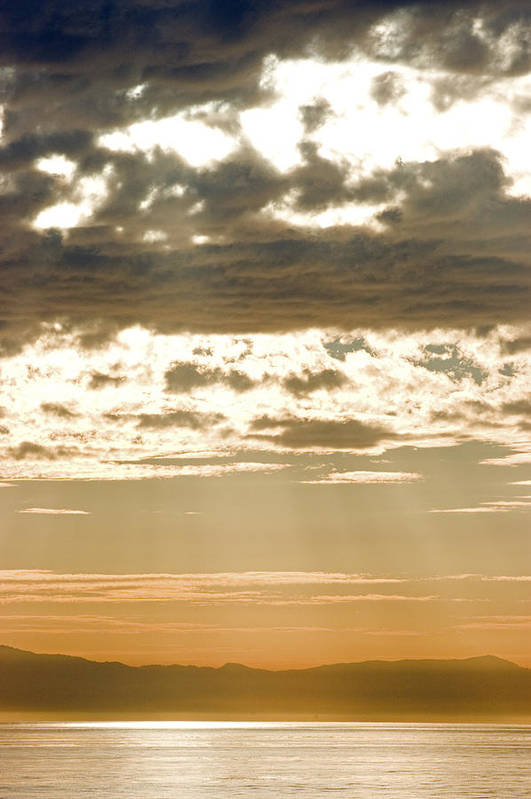 Islands Poster featuring the photograph Sun Rays And Clouds Over Santa Cruz by Rich Reid
