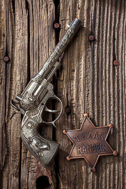 Toy Poster featuring the photograph Toy Gun And Ranger Badge by Garry Gay