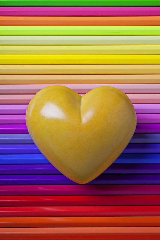 Yellow Heart Stone Love Symbol Romance Poster featuring the photograph Yellow Heart On Row Of Colored Pencils by Garry Gay