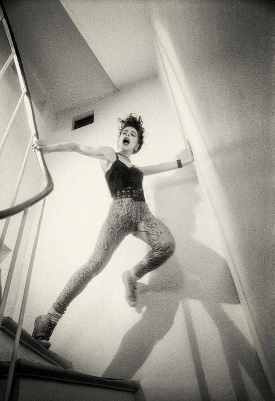 Photography Poster featuring the photograph Running Down The Stairs by Philippe Taka