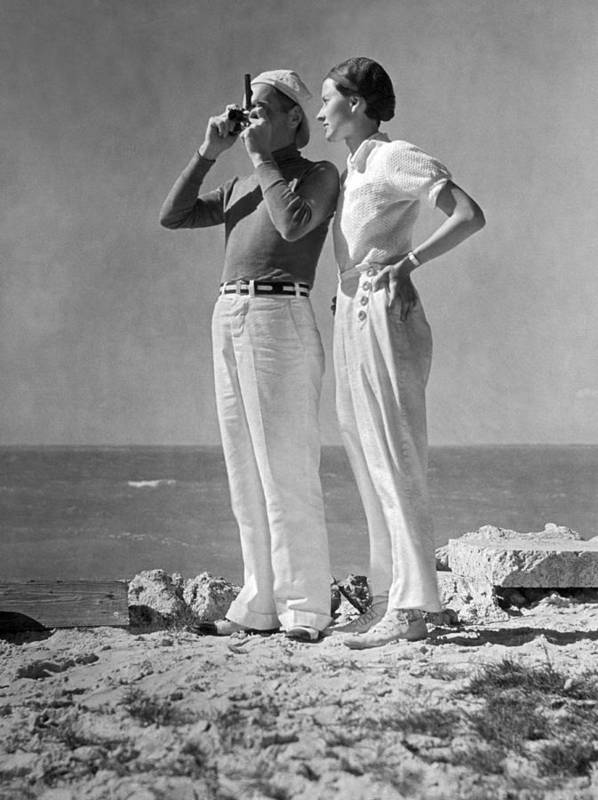 1938 Poster featuring the photograph Couple On The Maine Shore by Underwood Archives