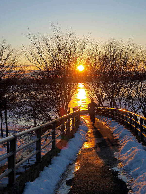 Blue Boston Bridge Ice Jog Jogging Life Magnificent Melting Nature Never Passion River Running Shadow Shinning Sky Snow Splendid Sport Sports Stop Sun Sunset Wet Winter Poster featuring the photograph Running In Sunset by Paul Ge
