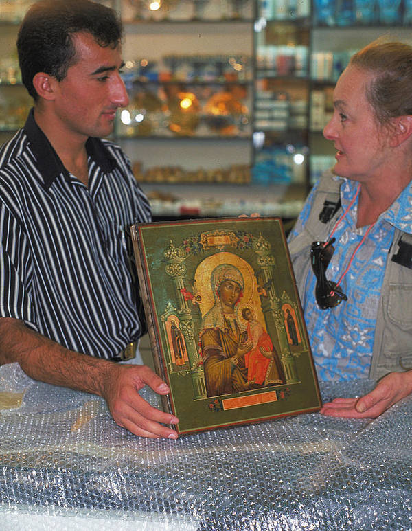Negotiating Poster featuring the photograph Buying Icon In Jerusalem by Carl Purcell