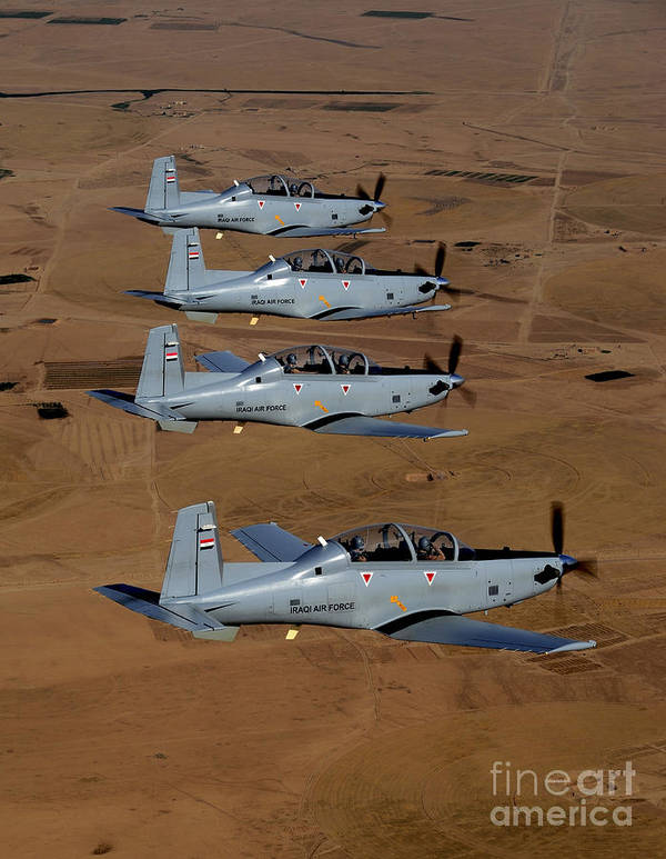 Trainer Poster featuring the photograph A Formation Of Iraqi Air Force T-6 by Stocktrek Images