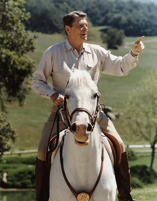 Ronald Reagan Poster featuring the photograph Ronald Reagan On Horseback by War Is Hell Store