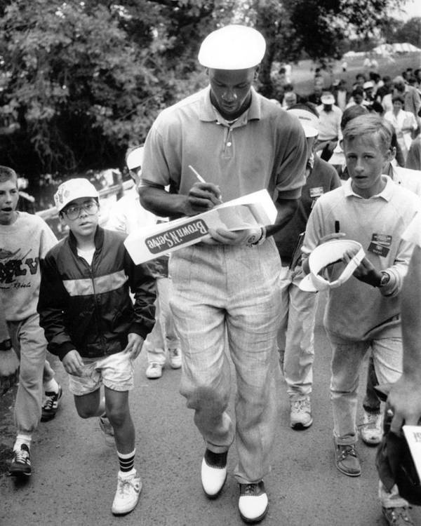 Classic Poster featuring the photograph Michael Jordan Signing Autographs by Retro Images Archive