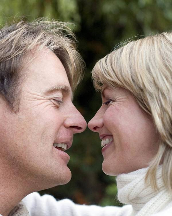 Human Poster featuring the photograph Smiling Couple Embracing by Ian Boddy