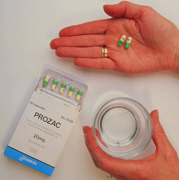Prozac Drug Poster featuring the photograph Prozac Pack With Pills In Hand And Glass Of Water by Damien Lovegrove