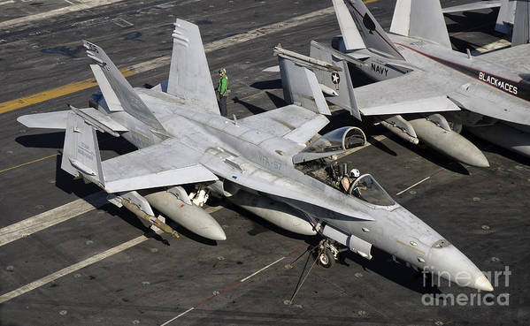 Operation Enduring Freedom Poster featuring the photograph A Us Navy Fa-18c Hornet Parked by Giovanni Colla