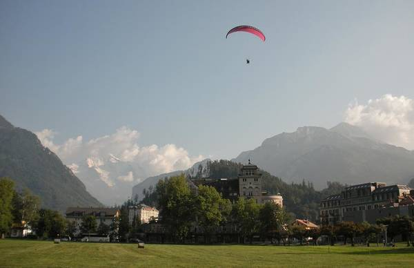 Europe Poster featuring the photograph Hang Gliding In Interlaken Switzerland by Marilyn Dunlap