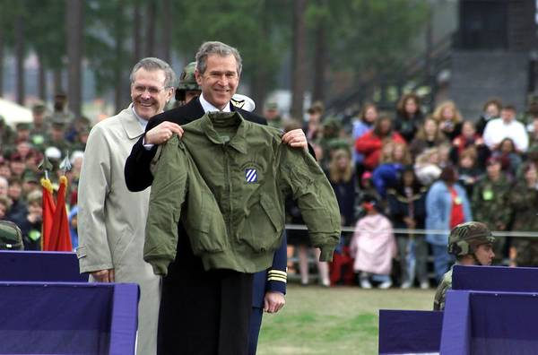 History Poster featuring the photograph President Bush Displays A Jacket Given by Everett