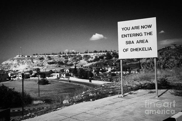 Sba Poster featuring the photograph sign overlooking pyla and turkish controlled territory marking entrance of SBA Sovereign Base area by Joe Fox
