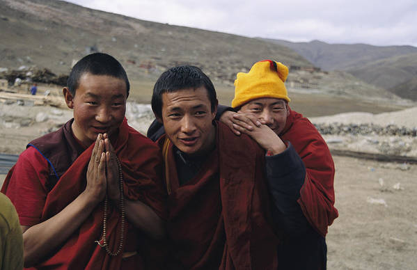 Religion Poster featuring the photograph Three Buddhist Lamas In Gansu Province by David Edwards