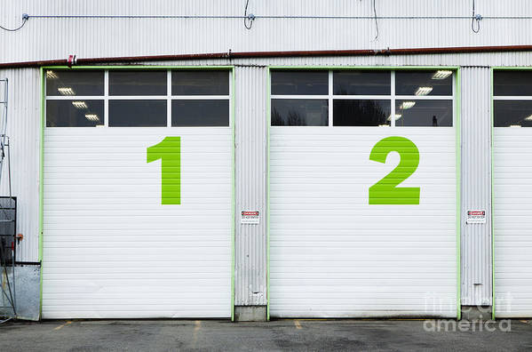 1 Poster featuring the photograph Numbers On Repair Shop Bay Doors by Don Mason