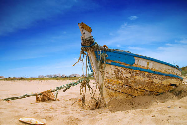Fishing Boat Poster featuring the photograph Dilapidated Boat At Ferragudo Beach Algarve Portugal by Amanda And Christopher Elwell