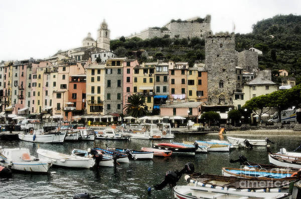 Monterosso Village In The Cinqueterre With Boats Docked In The Harbour Poster featuring the photograph Italian Seaside Village by Jim Calarese