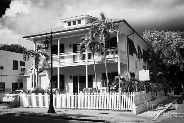 Old Poster featuring the photograph Old Historic Wooden Two Storey Building With White Picket Fence Key West Florida Usa by Joe Fox