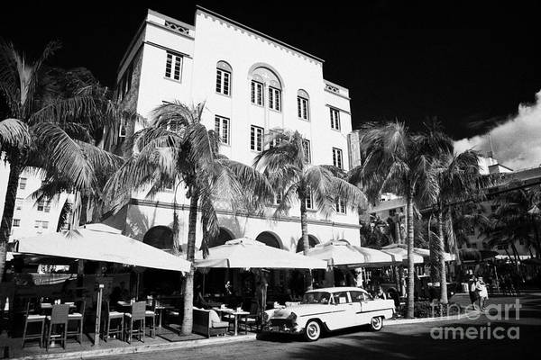 Orange Poster featuring the photograph Orange Chevrolet Bel Air In The Cuban Style Outside The Edison Hotel by Joe Fox