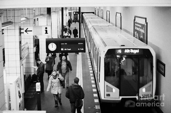 Berlin Poster featuring the photograph passengers on ubahn train platform as train leaves Friedrichstrasse u-bahn station Berlin Germany by Joe Fox
