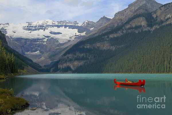 Canoe Poster featuring the photograph Red Canoes On Lake Louise by Teresa Zieba