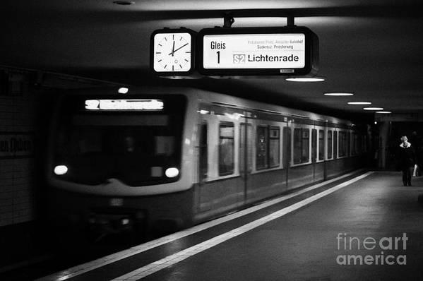 Berlin Poster featuring the photograph s-bahn train speeding through unter den linden underground station Berlin Germany by Joe Fox