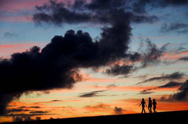 Silhouette Poster featuring the photograph Silhouettes Of Three Girls Walking In The Sunset by Fabrizio Troiani