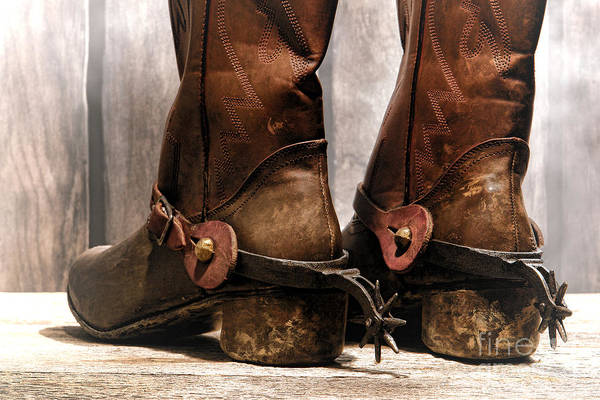 Cowboy Poster featuring the photograph The Muddy Boots by Olivier Le Queinec
