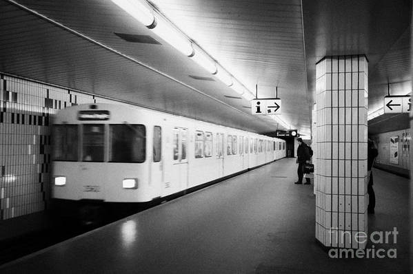 Berlin Poster featuring the photograph u-bahn train pulling in to ubahn station Berlin Germany by Joe Fox