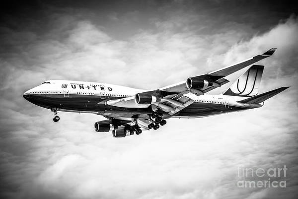 747 Poster featuring the photograph United Airlines Boeing 747 Airplane Black And White by Paul Velgos
