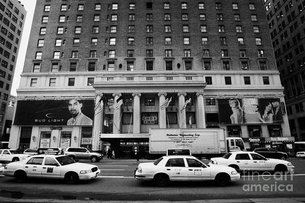 Usa Poster featuring the photograph Yellow Cabs Go Past Pennsylvania Hotel On 7th Avenue New York City Usa by Joe Fox
