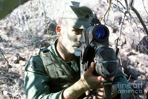 Military Poster featuring the photograph An Army Ranger Sets Up An Anpaq-1 Laser by Stocktrek Images