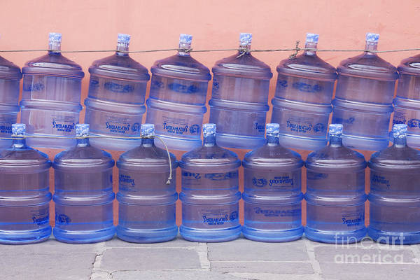 Bottle Poster featuring the photograph Rows Of Water Jugs by Jeremy Woodhouse