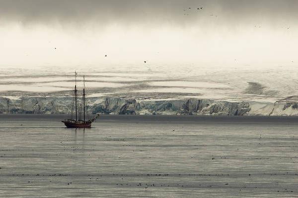 Outdoors Poster featuring the photograph A Double-masted Sailboat Floats Near An by Norbert Rosing