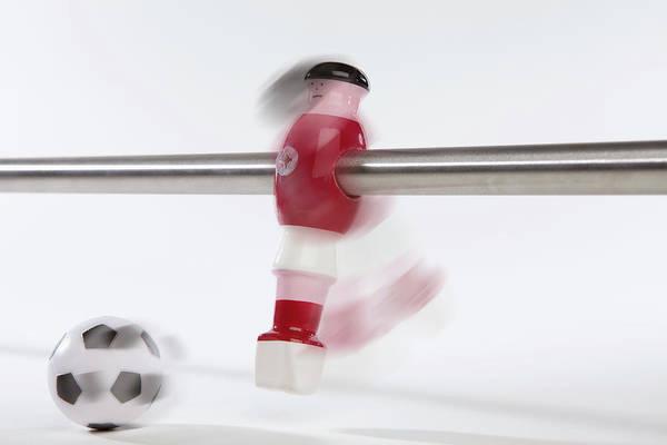 Horizontal Poster featuring the photograph A Foosball Figurine Kicking A Soccer Ball, Blurred Motion by Caspar Benson
