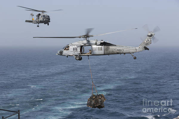 Arabian Sea Poster featuring the photograph A Mh-60s Knighthawk Transfers Cargo by Gert Kromhout
