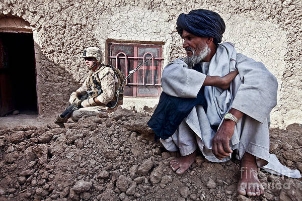 Middle East Poster featuring the photograph A Soldier Collects Information by Stocktrek Images
