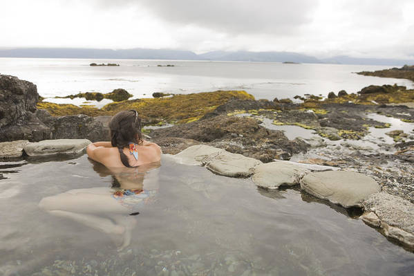 Queen Charlotte Islands Poster featuring the photograph A Woman Enjoys A Hot Spring by Taylor S. Kennedy
