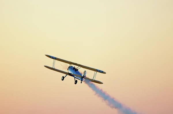 Horizontal Poster featuring the photograph Airshow Smoke Trail At Sunset by Jim McKinley