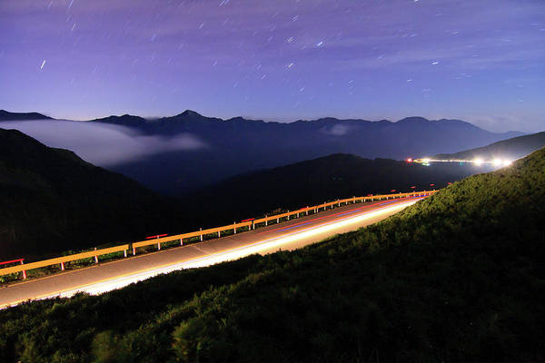 Horizontal Poster featuring the photograph Car Light Trails And Star Trails At Night by Samyaoo