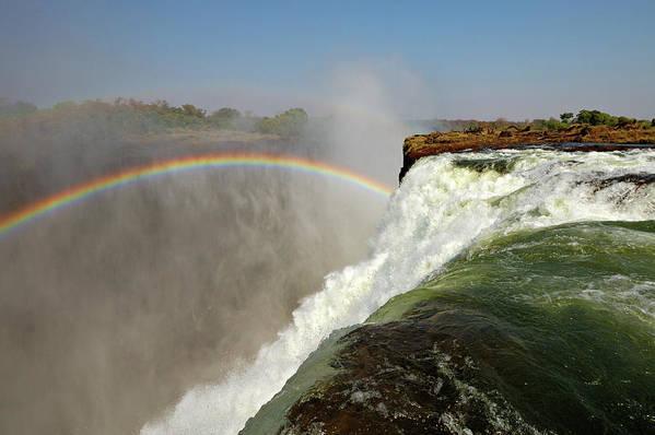 Horizontal Poster featuring the photograph Falling Down Falls, Zambia by © Pascal Boegli