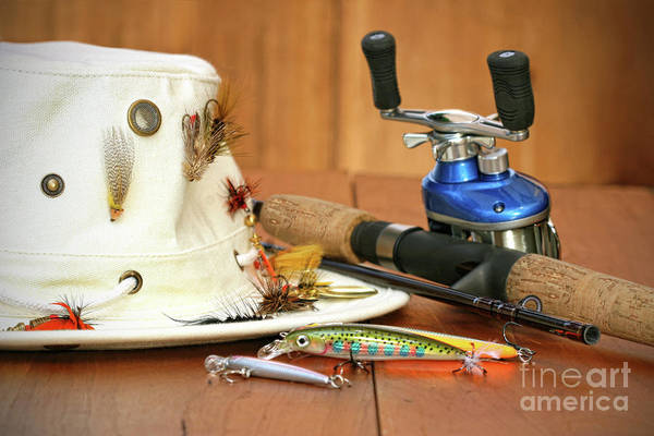 Activity Poster featuring the photograph Fishing Reel With Hat And Color Lures by Sandra Cunningham