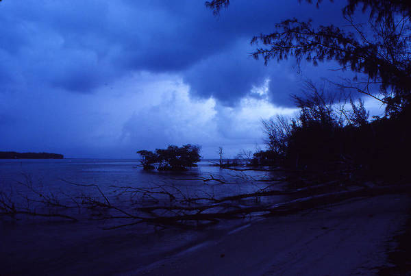 First Light Poster featuring the photograph Lifting Storm by Bob Whitt