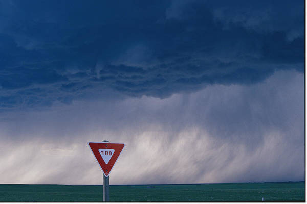 Sky Poster featuring the photograph Rain Pours Out Of Dark Clouds On Plains by Carsten Peter