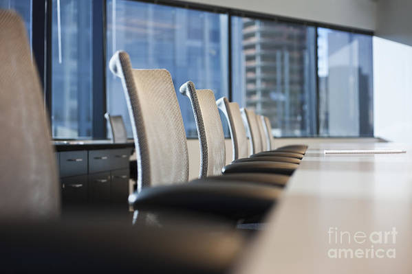 Architectural Detail Poster featuring the photograph Row Of Chairs And A Table In A Conference Room by Jetta Productions, Inc