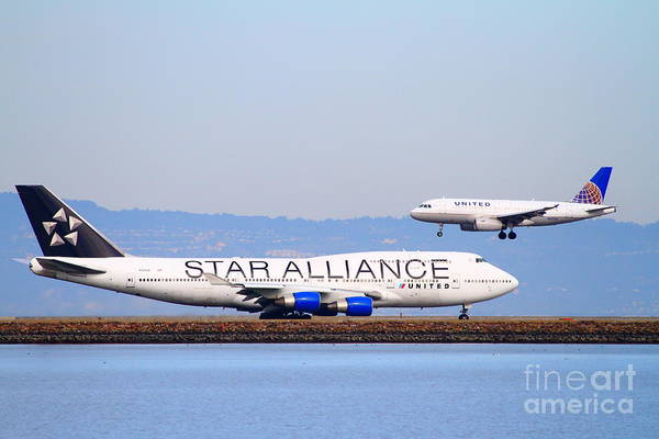 Airplane Poster featuring the photograph Star Alliance Airlines And United Airlines Jet Airplanes At San Francisco International Airport Sfo by Wingsdomain Art and Photography