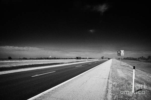 Signposts Poster featuring the photograph Trans Canada Highway 1 And Yellowhead Route In Manitoba Canada by Joe Fox